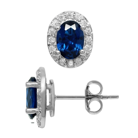 Created 1.6 Ctw Oval 7x5 mm Blue Sapphire 925 Sterling Silver Halo Stud Earrings
